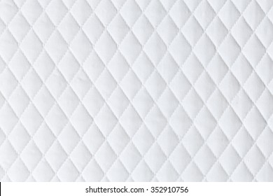 white mattress bedding pattern background. backdrop surface for design art work.