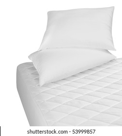 White mattress and pillows over white.