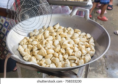 White Meat Ball made of Fish , Popular Thailand Street Food or Snack, Fried in Frying Pan with Boiled Vegetable Oil.