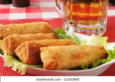 white meat chicken egg rolls with a mug of beer