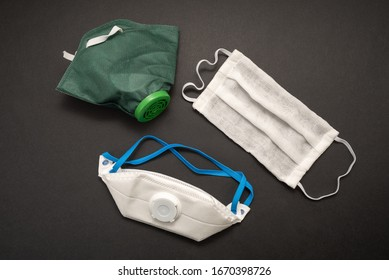 White medical mask on black background. Protective face mask against pollution, viruses, flu and coronavirus. Health care and surgical concept.