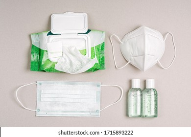 White medical masks and respirators with antibacterial wet wipes, disinfectant spray and hand sanitizer. Personal hygiene product for protection virus, flu, coronavirus, COVID-19