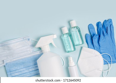 White medical masks and respirators with glove, hand sanitizer on blue background.  Face mask protection  KN95 or N95 and surgical masks for protection virus, flu, coronavirus, COVID-19.