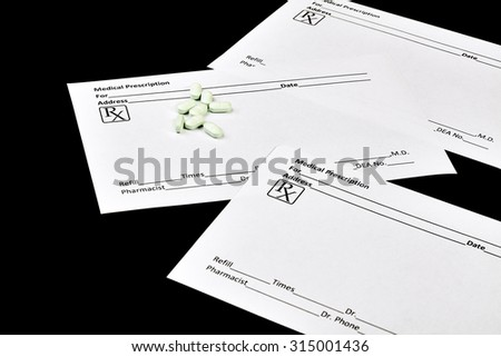 White Medical Prescription Forms With Pills Isolated On Black
