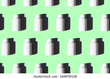 white medicine bottles pattern on mint green background
