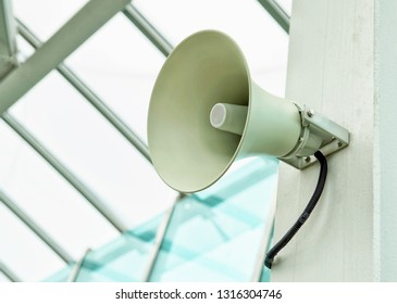 White megaphone, large alert loudspeaker close-up.