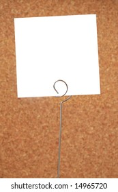 White memo card on brown background