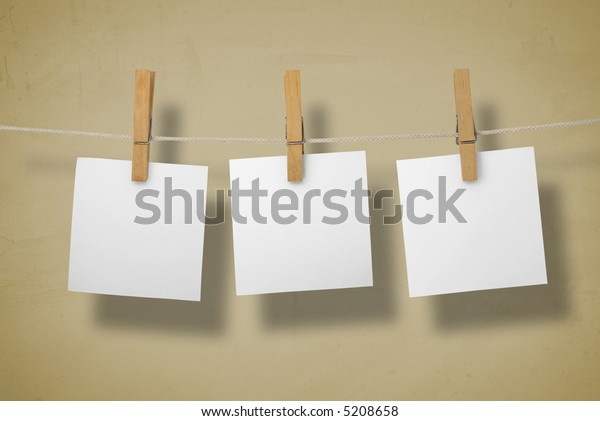 White memos on a clothesline.