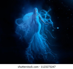 A white mermaid, with very long and blue hair floating under the water. An unusual image, the tail of a jellyfish. Levitation and weightlessness. Pale skin, gentle makeup. Art photo Creative wallpaper