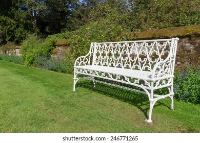 White metal benches in Scone Palace gardens, Scotland