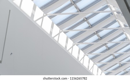 White metal construction of the glass roof of a large shopping center. Abstract high-tech architecture background photo