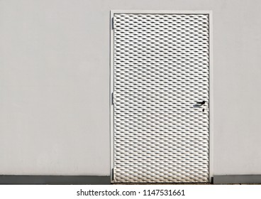 White metal door for exterior, with embossed small rhomboid shapes on all its surface
