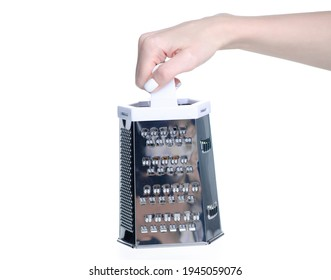 White metal kitchen grater in hand on white background isolation