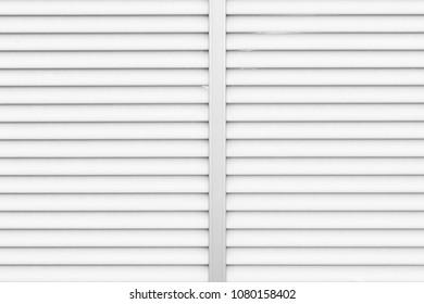 White metal sliding shutter window