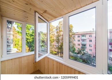 White metal-plastic windows of balcony in modern apartment