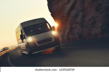 white minibus drive along a mountains coast