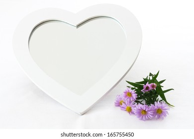 White mirror with heart shaped wood frame - isolated on white