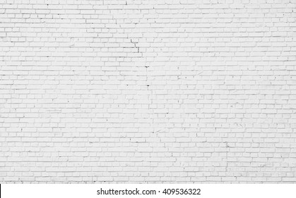 White misty brick wall with a large crack for background or texture