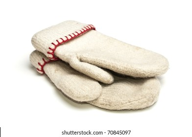 White mittens with red thread over white background
