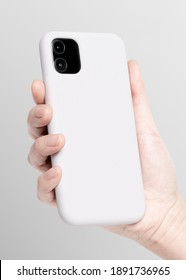 White mobile phone case mockup in hand product showcase b