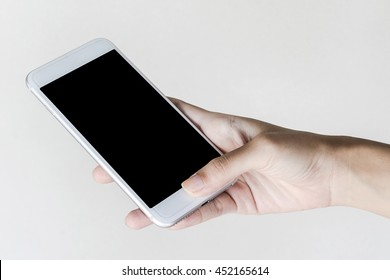 white mobile phone on Asian woman hand with wooden background, close-up, selective focus on hand