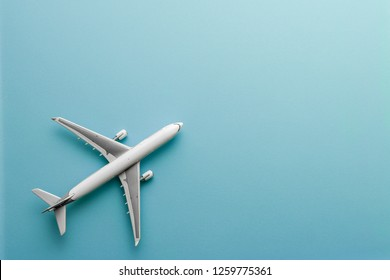 White model airplane  on pastel color background with copy space  flat lay design