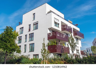 White modern apartment house with metal balconies seen in Berlin, Germany