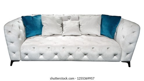 White modern chesterfield style velours sofa with pillow quilted upholstery close up. Capitone pattern texture background. Soft contemporary couch with cushions isolated background