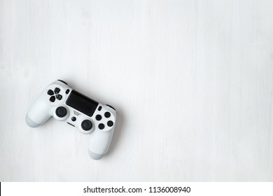 White modern gamepad on white wooden background