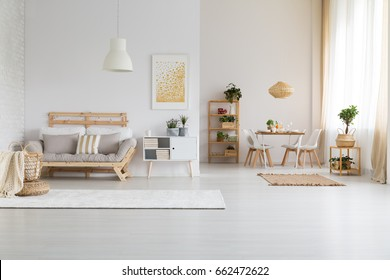 White, modern open space with wooden furniture set