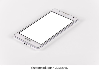 White modern smartphone with blank screen lies on the surface, isolated on white background. Selective focus