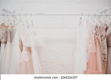 White modern wedding dresses in dress store.