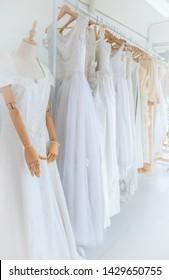 White modern wedding dresses in dress store. / wedding dresses on mannequins