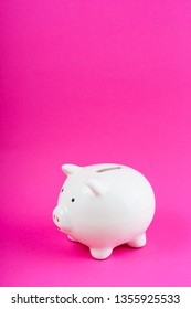 White Money Save Pig on Pink Background Copy Space. Finance Box Concept. Empty Budget Ceramic Moneybox Symbol. Cash Safe Box Business Object