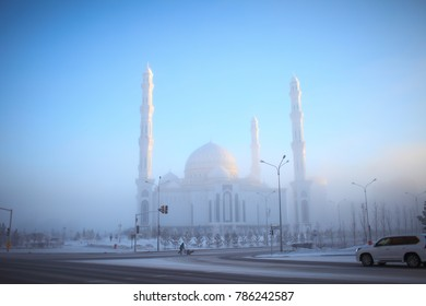 White mosque in the winter urban fume.