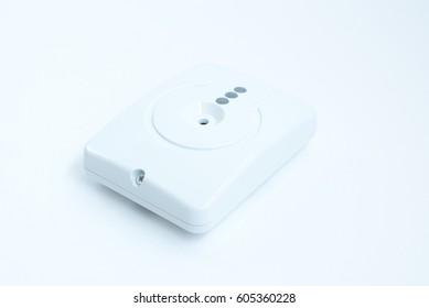 White motion sensor isolated on white background.