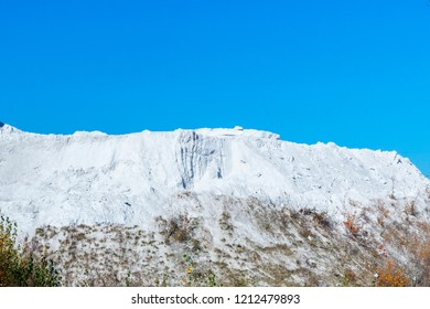 White mountain of phosphoric waste of chemical plant. pit refuse heap of waste of chemical production. Concept environmental pollution, Ecological