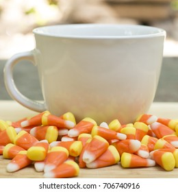 white mug with candy corn