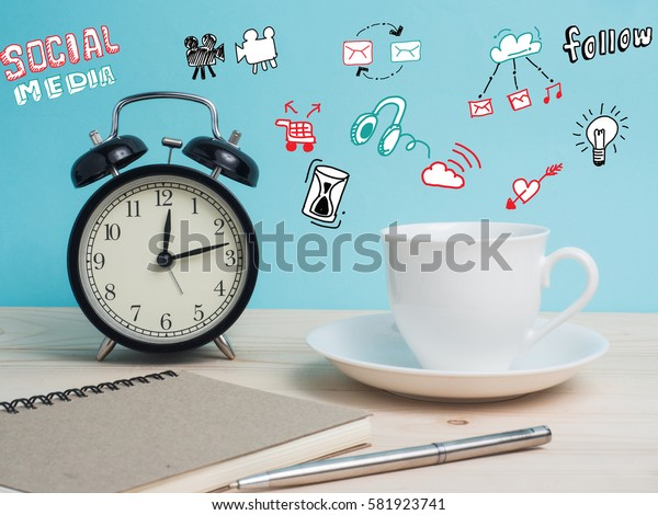 White mug  and clock on wooden table over grunge background.Concept coffee break or tea time. Create idea from copy space on color background.