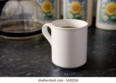 A white mug of coffee