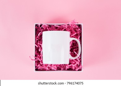 white mug mock up on a pink background