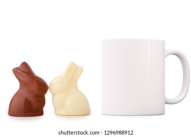 White Mug Mockup - Easter theme. White blank mug next to two chocolate bunnies. Perfect for businesses selling mugs, just overlay your quote or design on to the image.