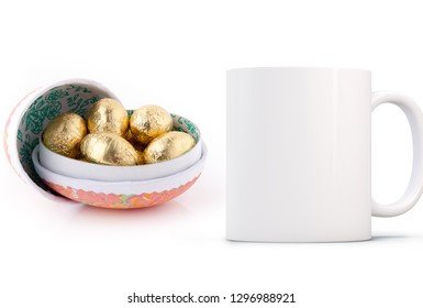 White Mug Mockup - Easter theme. cardboard open egg with mini chocolate eggs inside next to a blank white mug. Perfect for businesses selling mugs, just overlay your quote or design on to the image.