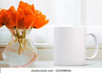 White Mug Mockup - Easter theme. Blank coffee mug next to a vase of tulips. Perfect for businesses selling mugs, just overlay your quote or design on to the image.