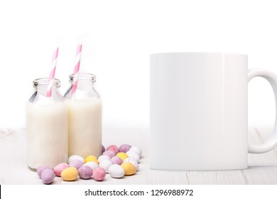 White Mug Mockup - Easter theme. Two mini milk bottles and chocolate mini eggs next to a blank white mug. Perfect for businesses selling mugs, just overlay your quote or design on to the image.