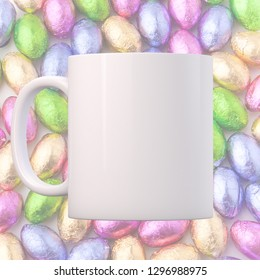 White Mug Mockup - Easter theme. White blank mug on an Easter background of foil wrapped chocolate mini eggs. Perfect for businesses selling mugs, just overlay your quote or design on to the image.