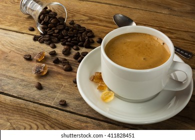 White mug of morning coffee. Cup of coffee and brown sugar. Strong coffee.
