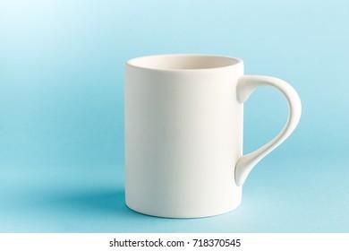 White mug on blue background