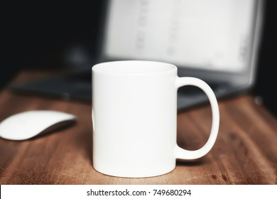 White mug on the wooden table