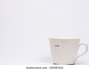 White Mug with word love on it